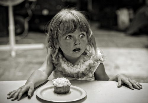 Girl In Front Of Cake
